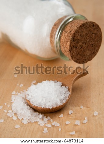 Sea Salt in Bamboo Wooden Spoon - stock photo