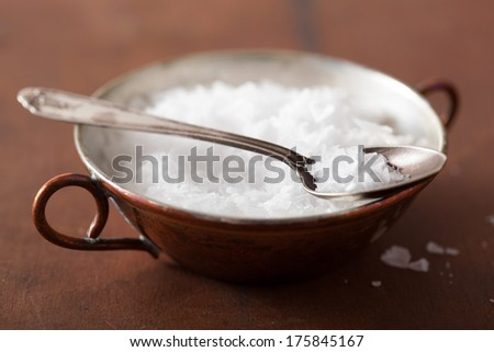 sea salt in vintage bowl and spoon  - stock photo