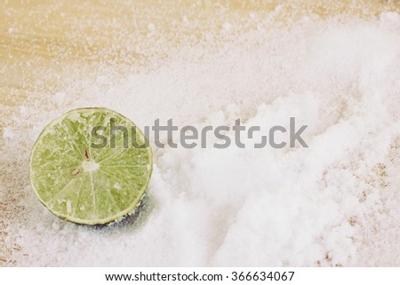 sea salt on lemon use for background - stock photo