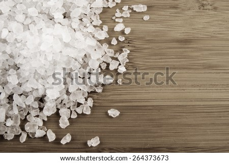 Sea salt on wooden background - stock photo