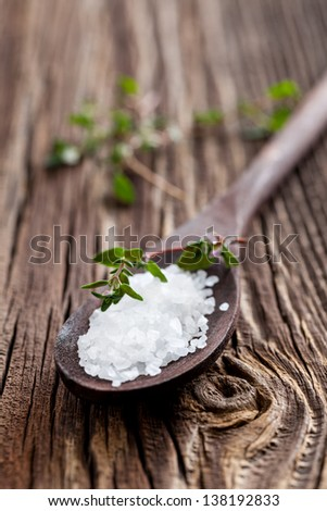sea salt on wooden spoon - stock photo