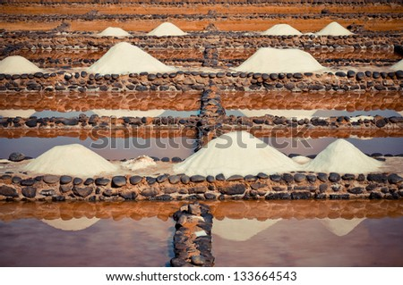 Sea salt. Traditional production from ocean water. Salinas del Carmen. Fuerteventura - stock photo