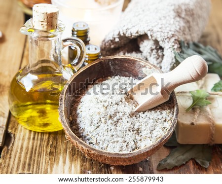 Sea Salt Treatment with Dried Flowers, Olive Oil, Essential Oils for Wellness Therapy  - stock photo