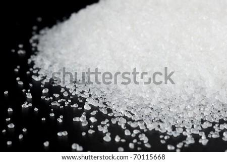 Sea salt with black background - stock photo