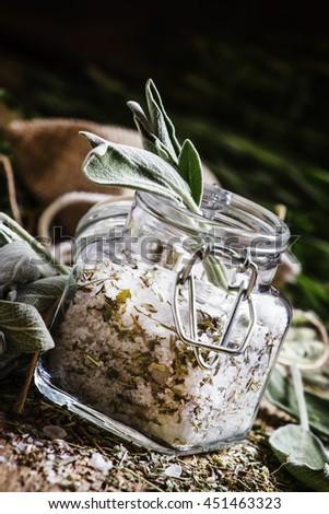 Sea salt with herbs, selective focus - stock photo