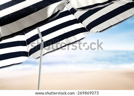 sea sand and umbrella  - stock photo