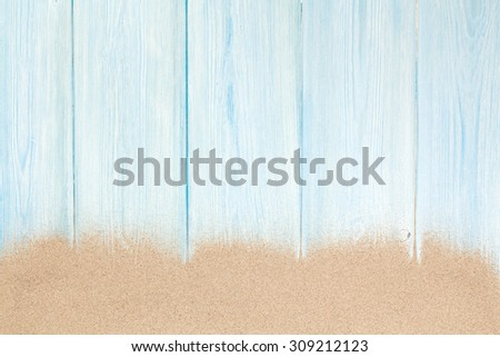 Sea sand on wooden floor. Top view with copy space - stock photo