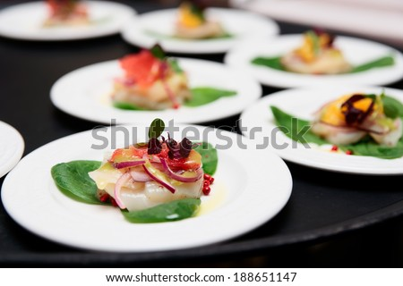 Sea scallop carpaccio dishes on tray - stock photo