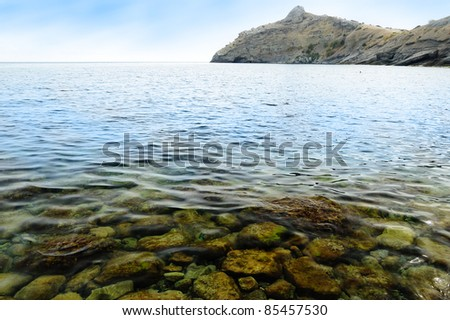 Sea shore and mountains - stock photo
