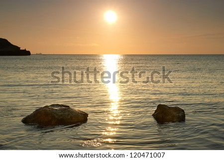 Sea shore and stones. Seascape at sunset. - stock photo