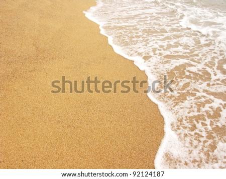 Sea shore, foamy water at Costa Brava(Spain) - stock photo