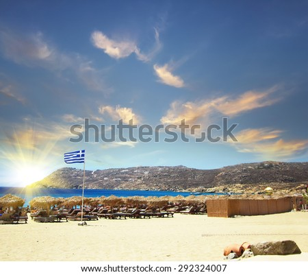 sea shore with golden beach and blue water at sunset, Greece - stock photo