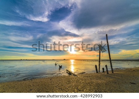 Sea shore with sunset background - stock photo