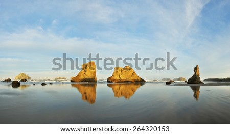 Sea stacks on Bandon beach at sunrise, Oregon coast  - stock photo