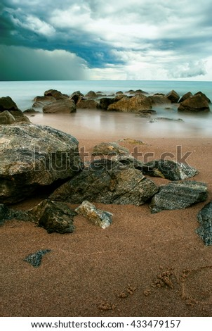 Sea stone and waves during sunrise storm. Natural composition. - stock photo