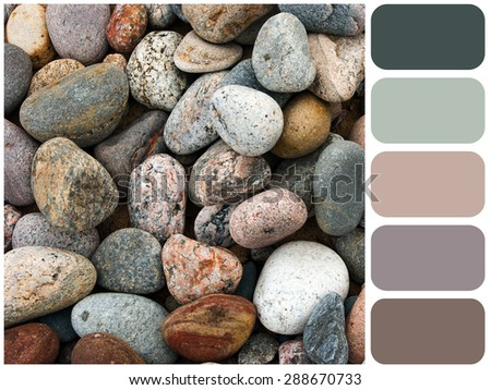 Sea stones background  texture, garden pile of pebbles, background colour palette with color swatch - stock photo