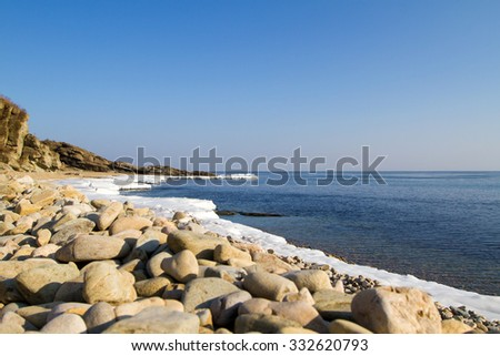 Sea stones, the stones on the beach.Icy shore of the sea, the ice Floe. North sea, the cold sea of the North, winter ice, white snow of the Arctic, Arctic ocean, Spring Arctic. The melting of ice. - stock photo