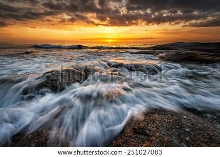 Sea sunrise with stormy sea near Burgas, Bulgaria - stock photo