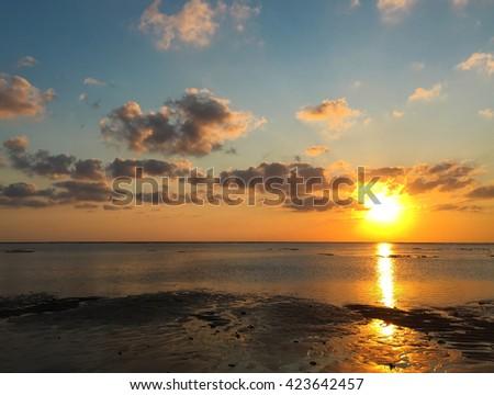 Sea, sunset time, soft light, Sea landscape, Sea background, Sea picture, sunset, sky and blue sea, Sea horizon, Bali sea, Indonesia, peaceful sea view, beach and sea, orange sun, fluffy clouds & sea - stock photo