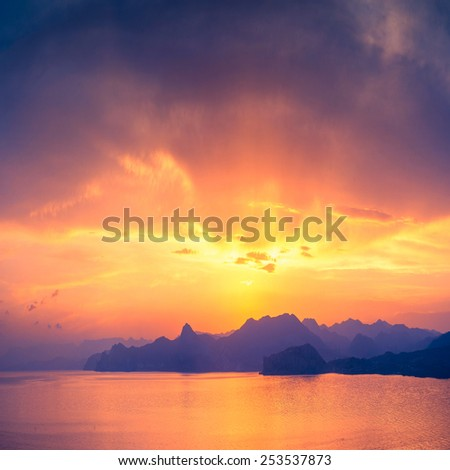 Sea sunset with beautiful reflection of sun light in water - stock photo