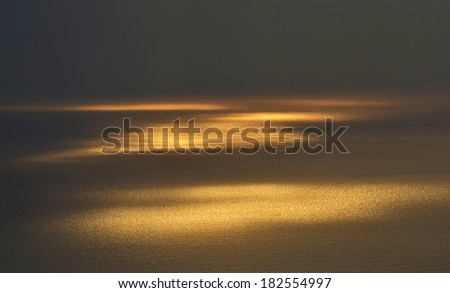 Sea surface in the sunset - stock photo