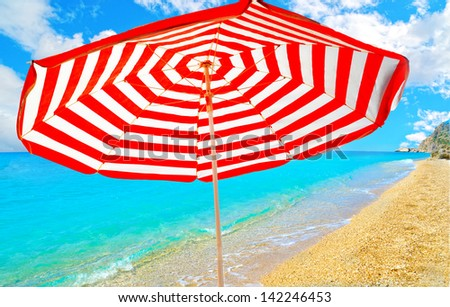 sea umbrella colors protection from the sun holidays - stock photo
