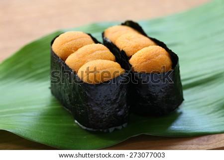 sea urchin roe, japanese sushi, uni gunkanmaki - stock photo