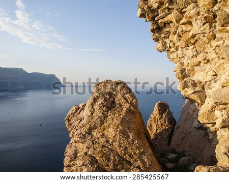 Sea view at dawn from the cliff into the Balaklava Bay. Crimea. - stock photo