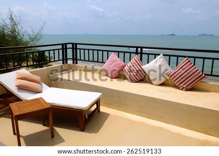 Sea view balcony with  day bed and cushions - stock photo