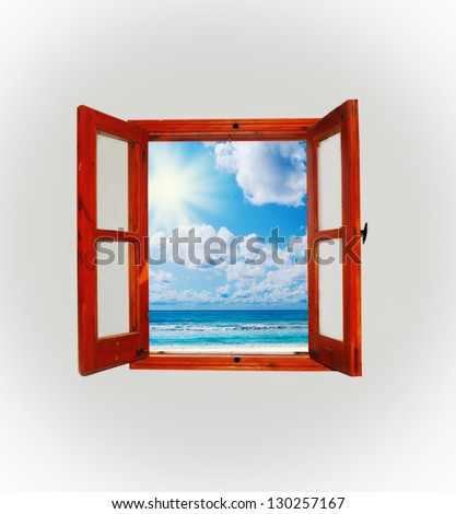 Sea view through an open window in a dark room - stock photo