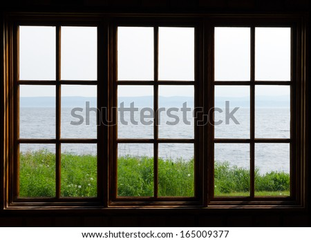 Sea view through window in sunny day - stock photo