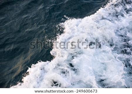 Sea water turbulent foam splash  - stock photo