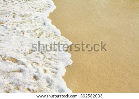 Sea wave and sandy beach  - stock photo