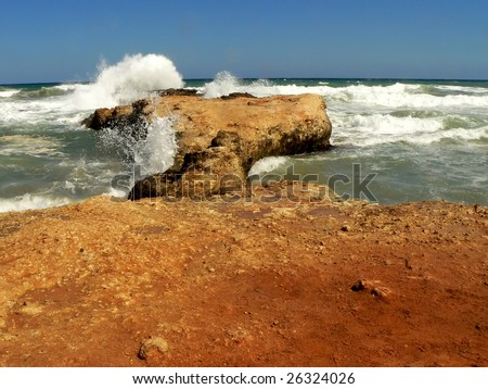 Sea wave crashing the stone - stock photo