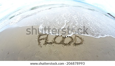 sea wave that erases the word flood on the Sea Beach photographed by fisheye lens 2 - stock photo