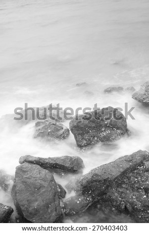 Sea waves and rocks - stock photo