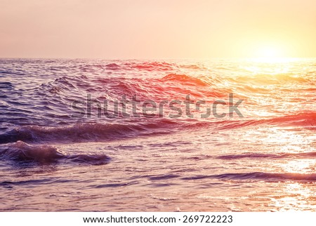 Sea waves at sunset. - stock photo
