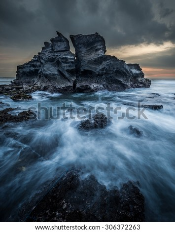 sea waves cliff rock dramatic color - stock photo