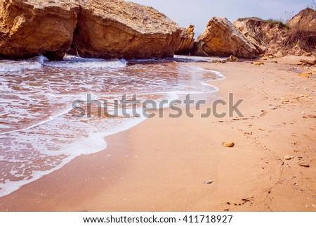 Sea waves crashing over rocks - stock photo