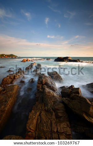 Sea waves  impact rock on the beach, Thailand - stock photo