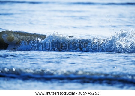 Sea waves with reflection - stock photo