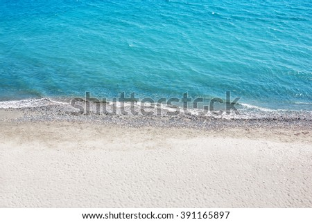 Sea with a white sand beach. Aerial view from above. Sea waves. - stock photo