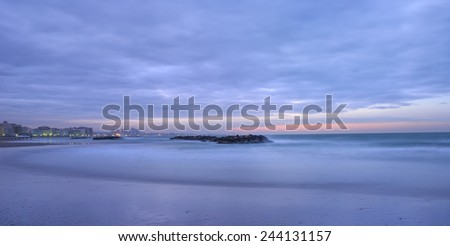 sea with calm water at sunset - stock photo