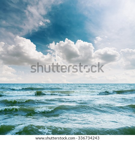 sea with waves and dramatic sky over it - stock photo