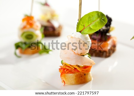 Seafood and Vegetables Canapes over White - stock photo