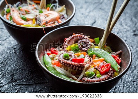 Seafood and vegetables served with noodles - stock photo