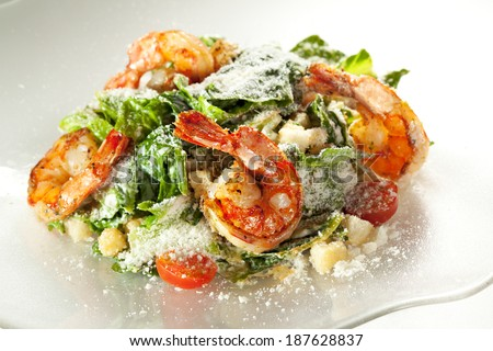 Seafood Caesar Salad with Shrimps, Salad Leaf, Croutons, Cherry Tomato and Parmesan Cheese - stock photo