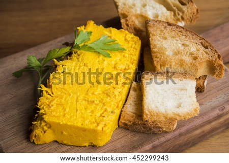 Seafood cake with toasted bread - stock photo