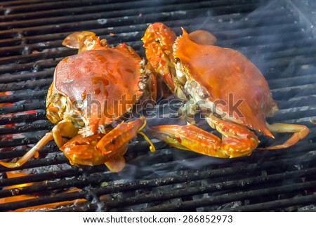 seafood crab by fire and BBQ Flames. Restaurant Barbecue at the night market - stock photo