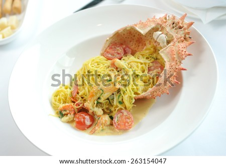 seafood dish lobster and  - stock photo